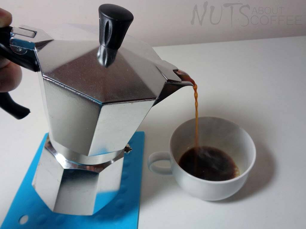 poring coffee from a stovetop coffee maker