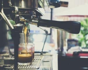 a espresso machine pouring 2 espressos