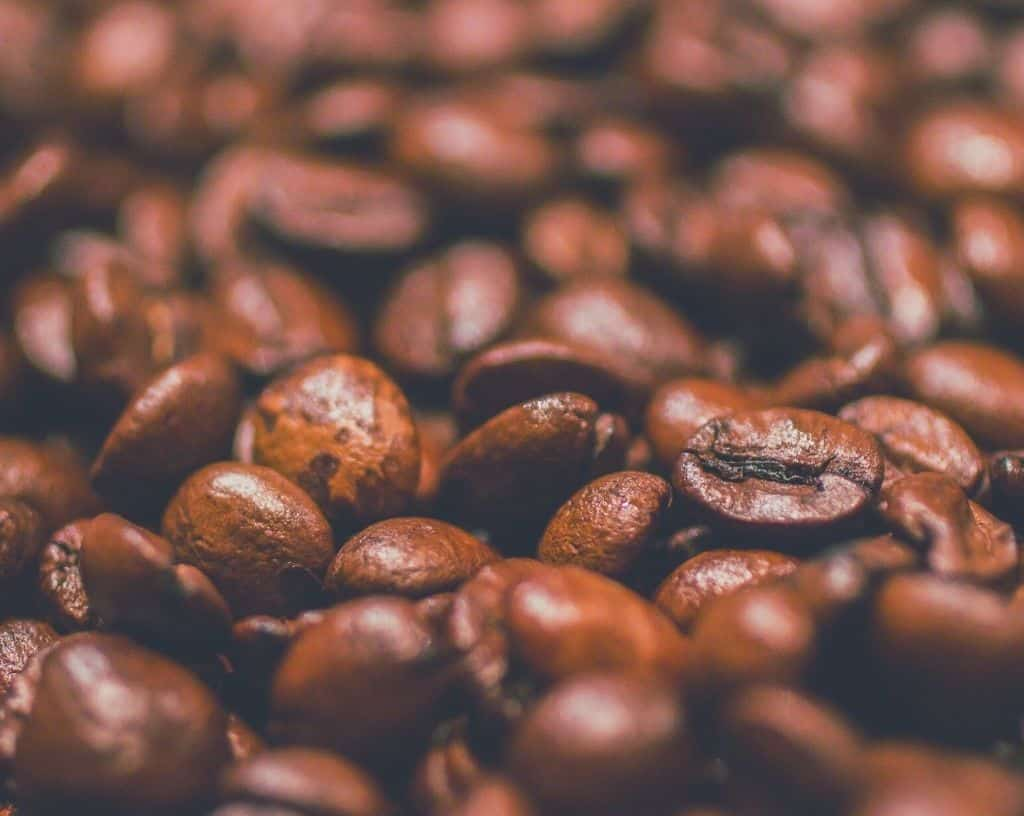 roasted coffee beans in a pile