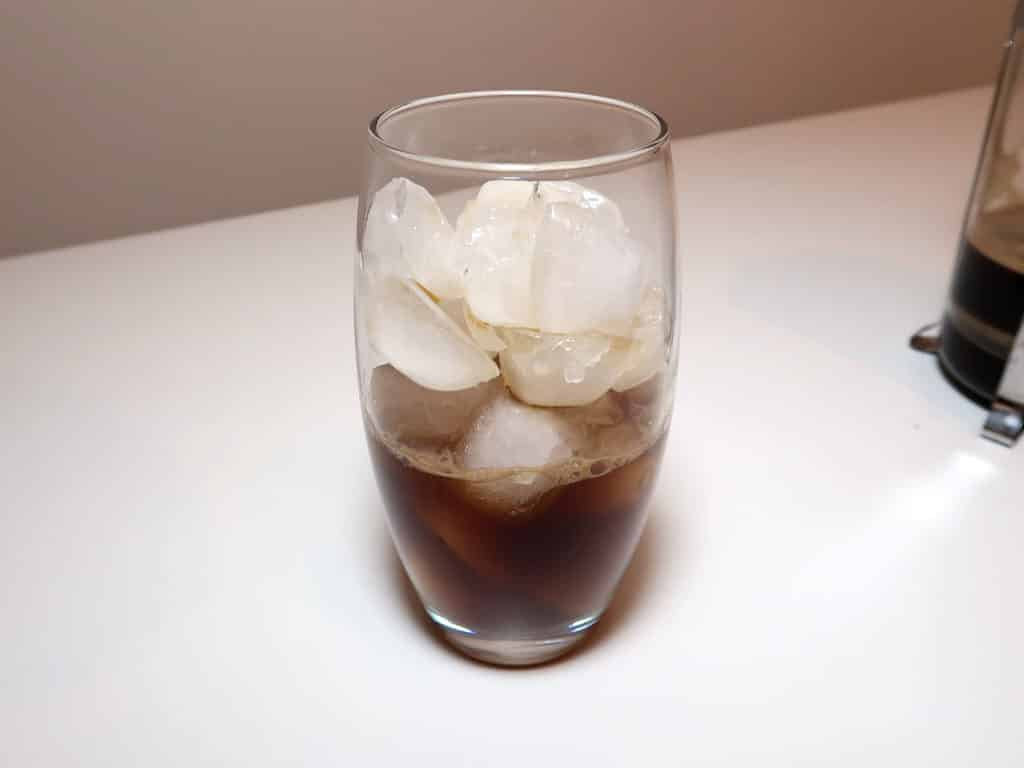 A glass of coffee poured over ice