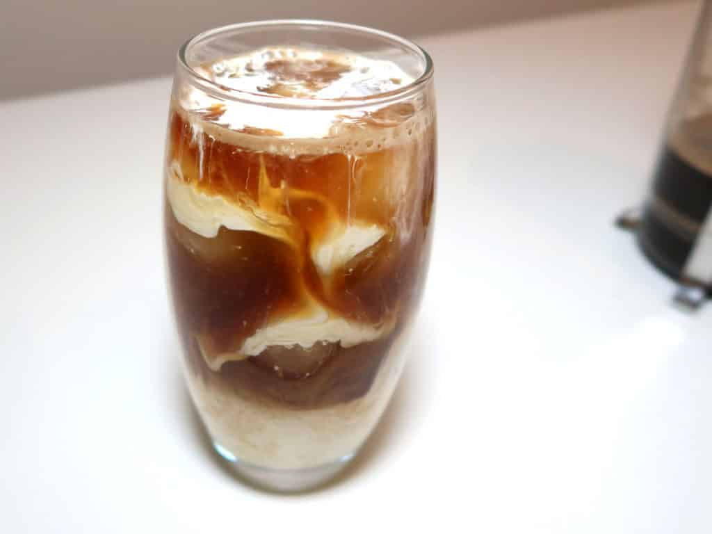 Half and half just added to coffee and ice to make an iced coffee